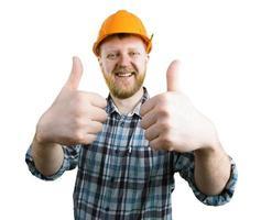 man in een helm laat zien dat alles goed is foto
