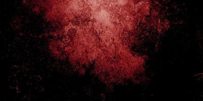 rode en zwarte horror achtergrond. donkere grunge rode textuur beton foto