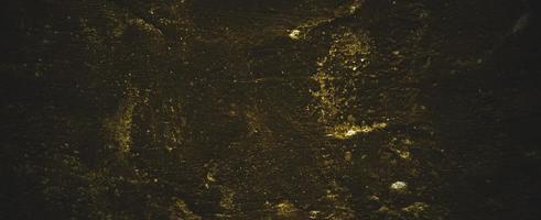 armoedige donkergele betonnen muur. donkerbruine muur beton of cement foto