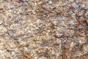abstracte aard grunge textuur achtergrond van donker bruin granieten rots. foto