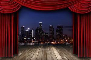 theater toneelgordijn gordijnen met een nachtstad als achtergrond foto
