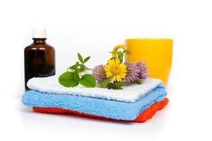 saunaset - handdoeken, kruidenolie en biologische thee foto
