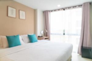 abstract vervagen bed in slaapkamer voor achtergrond foto