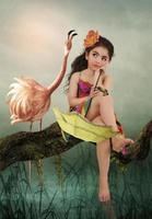 klein meisje en flamingo foto