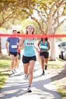 vrouwelijke atleet winnende marathon foto