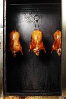 sluit omhoog het koken van Chinese eend foto