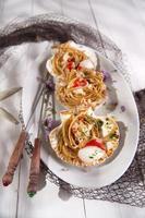 spaghetti met sint-jakobsschelpen foto