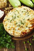 braadpan pasta met doperwtjes, courgette en kwark