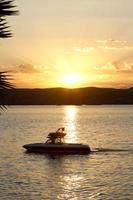 ski boot zonsondergang foto
