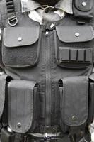 zwart swat vest foto
