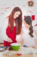 samengesteld beeld van feestelijke moeder en dochter samen bakken foto