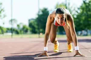 vrouwelijke sprinter klaar voor de vlucht