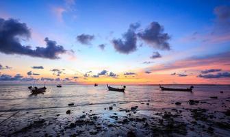 zonsondergang met strand foto