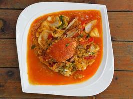 gebakken krab in gele curry, roergebakken krab curry foto