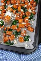 pompoen met spinazie en sesamzaadjes foto