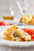duchesse aardappelen met champignons foto