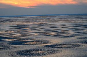nordsee im winter beim abendrot