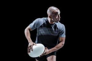 atleet met rugbybal foto