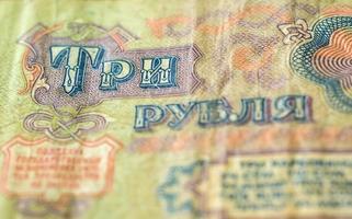 het oude sovjetbankbiljet drie roebels sluit omhoog foto
