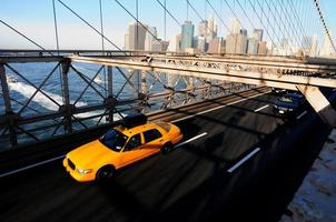 De gele taxi van New York, de brug van Brooklyn foto