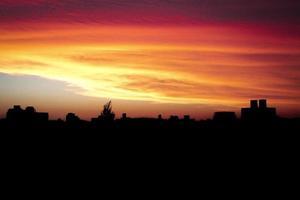 zonsondergang stad foto