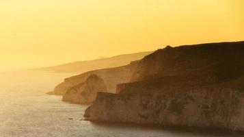 zonsondergang kust foto