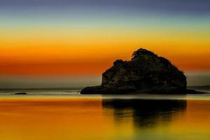 zonsondergang in strand foto