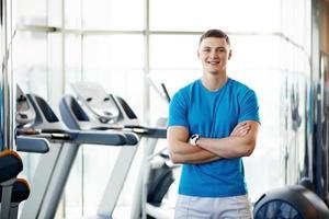 trainer in de sportschool foto