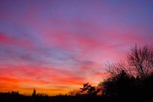zonsondergang oranje hemel foto