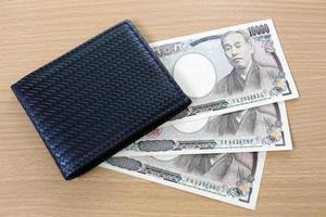 bankbiljetten van japan in portefeuille. foto