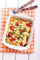 risotto van pompoen, tomaat en fetta foto