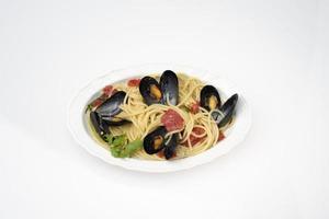 plaat van spaghetti met zeevruchten foto