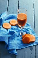 Pompoen- en wortelsap foto