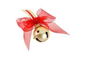 gouden kerst jingle bell met rode strik foto