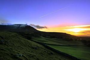 zonsondergang in de winter foto