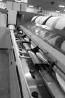 katoengroep in draaiende productielijnfabriek foto