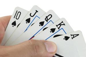 royal flush speelkaarten in de hand. foto