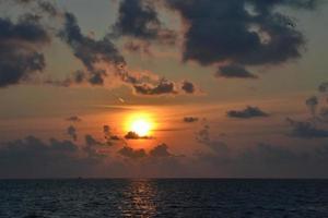 Golf zonsondergang foto