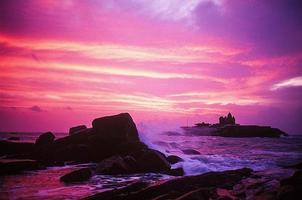 zonsondergang in cape comorin foto