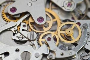 metalen tandwielen in uurwerk, concept teamwork foto