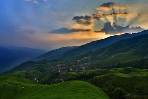 zonsondergang en terras foto