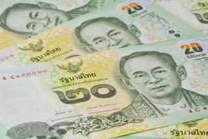 Thaise bankbiljetten (baht) voor geld en zakelijke concepten foto