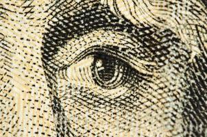 oog op een bankbiljet van dollar usa, macro foto