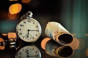 tijd en geld, bedrijfsconcept foto