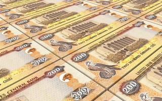 Verenigde Arabische Emiraten dirhams rekeningen stapels achtergrond. foto