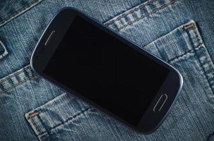 smartphone en spijkerbroek foto