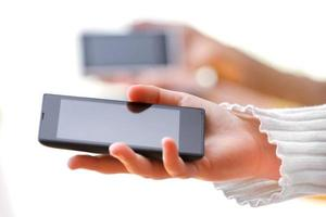 mobiele slimme telefoon in de hand foto