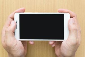 man hand met smartphone foto
