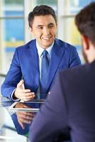 zakenlieden interactie foto
