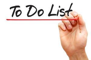 hand schrijven om lijst, bedrijfsconcept te doen. foto